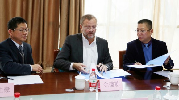 Signing the Agreement. L to R: Stephen Jan of OriginClear HK, JL Kindler of OriginClear, and partner.