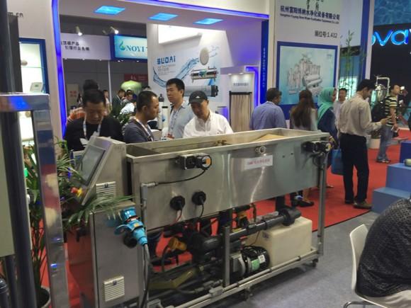 Visitors to Shanghai's Aqua Tech Innovation Pavilion observe a working demonstration of OriginClear's EWS technology.