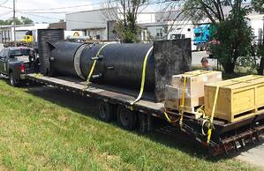 Twin pump stations being delivered for installation
